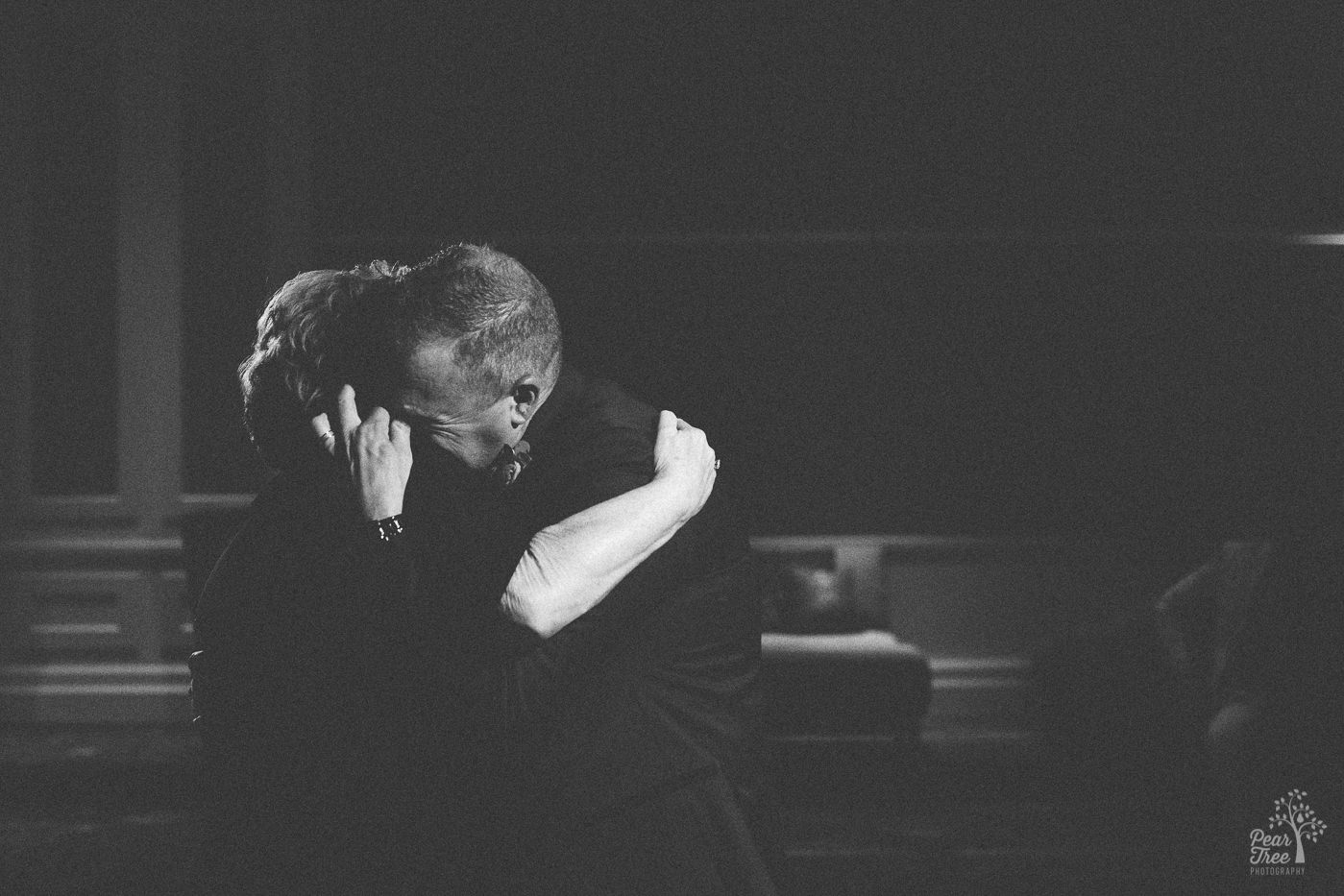 Groom hugging his mom tight during Mother-Son dance.