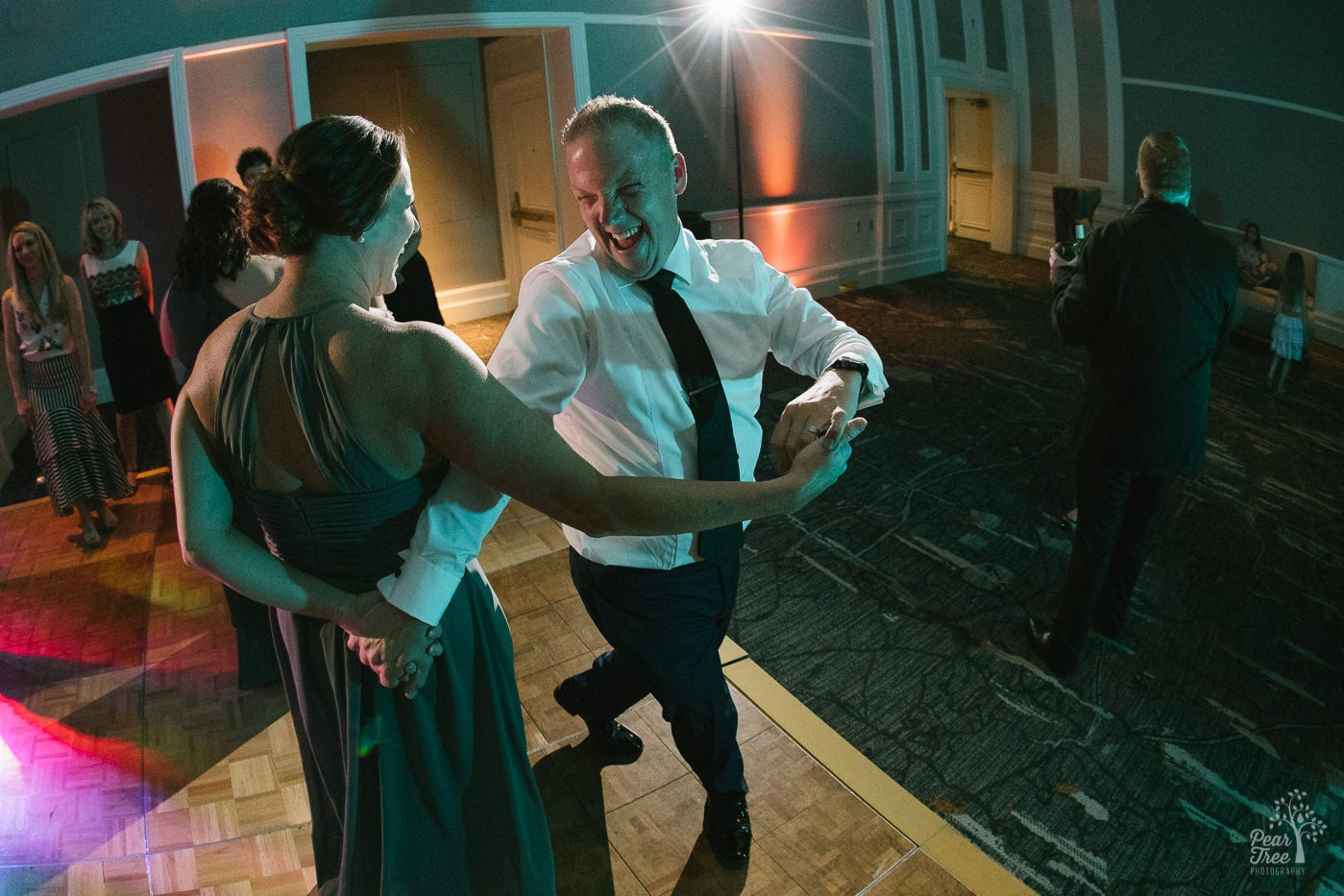 Groom dancing with maid of honor.