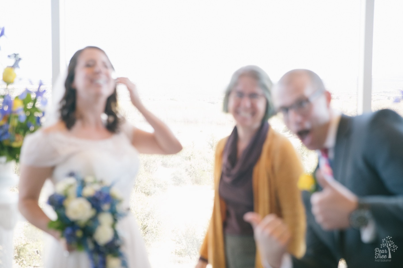 When a wedding photographer hands off her camera to be included in wedding formals, this is the resulting out-of-focus photograph