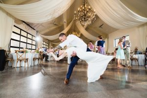 Bride and groom dancing with dramatic dip inside the Greystone Estate in Ballground, GA