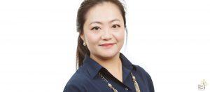 Headshot of a smiling asian woman