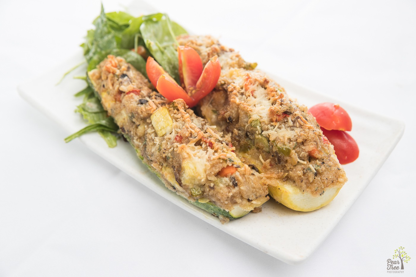 Delicious seafood stuff zucchini appetizer designed by Divine Taste of Heaven caterer.
