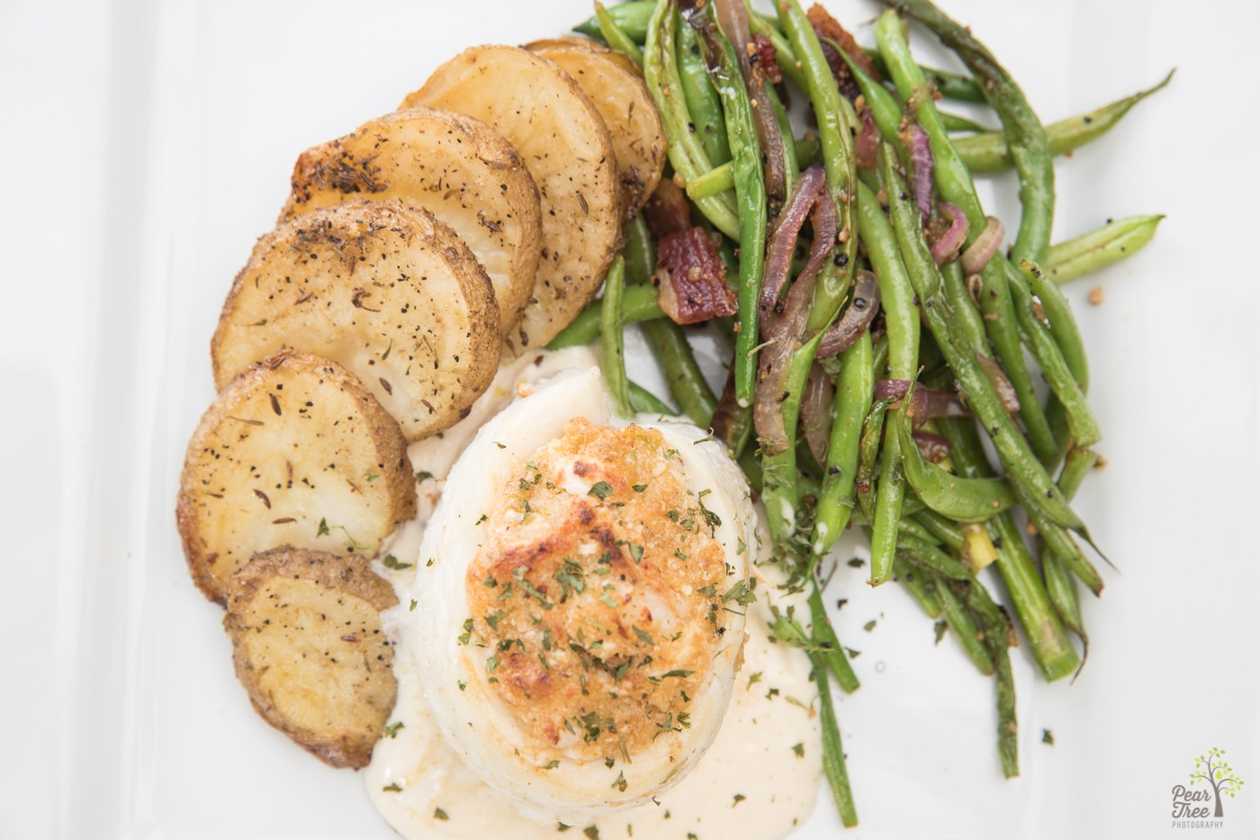 Stuffed tilapia, potatoes, and seasoned green beans with onions crafted by Divine Taste of Heaven.