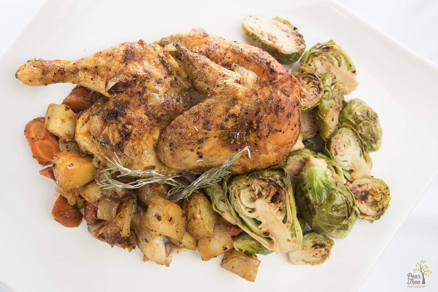 Roasted chicken with brussel sprouts, carrots, and potatoes made by caterer Divine Taste of Heaven.