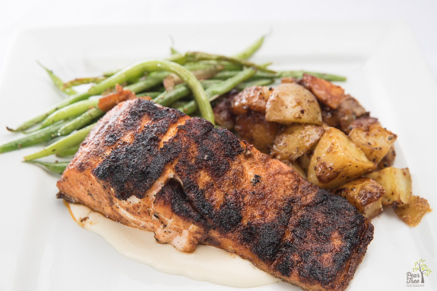 Baked cajun salmon served with fresh green beans and roasted potatoes catered by Divine Taste of Heaven.