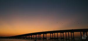 Sunset behind Destin bridge over Destin Harbor