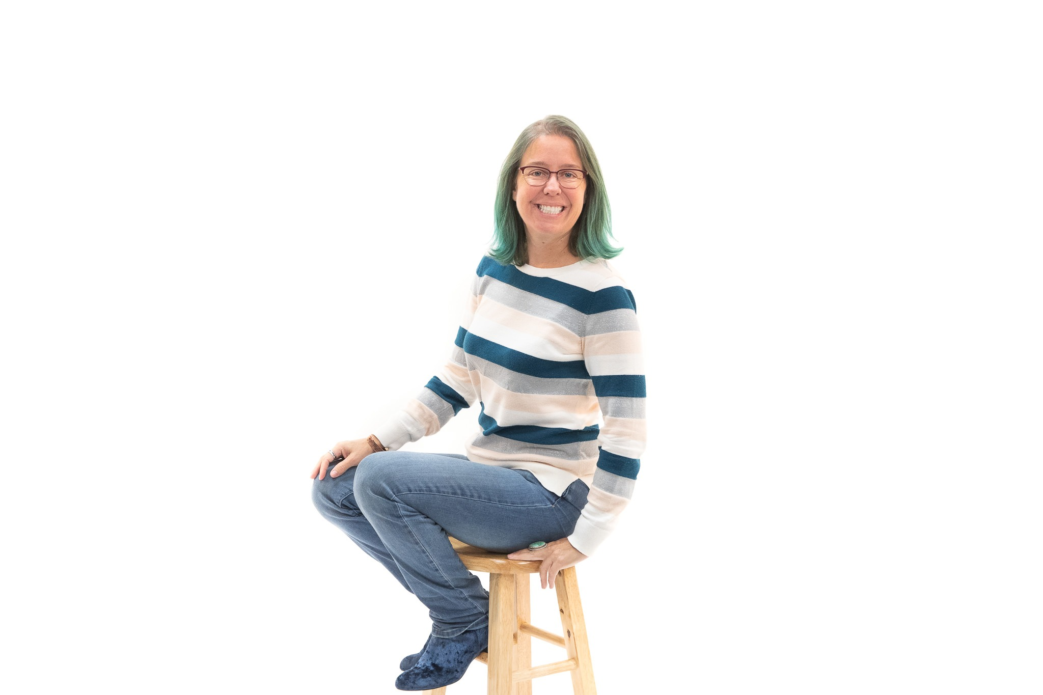 Kelley Wenzel sitting on stool
