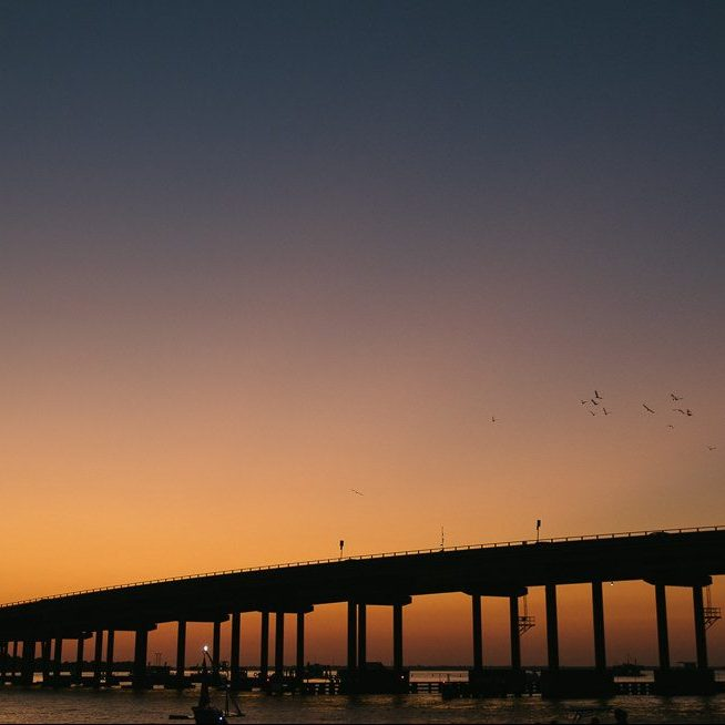 Sunset behind Destin bridge over Destin Harbor