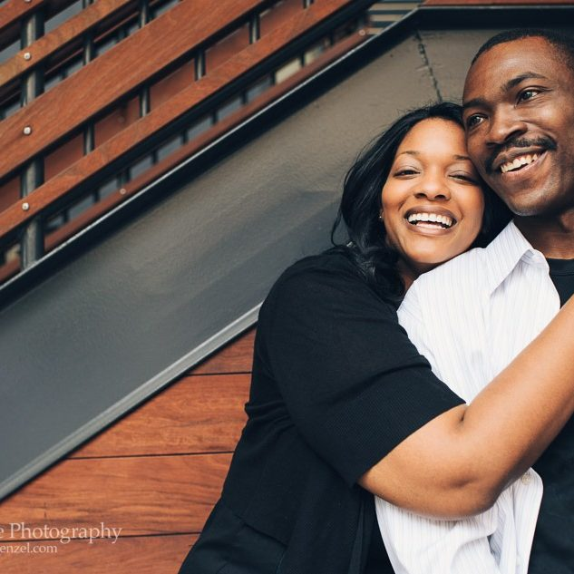 African American engaged couple hugging and laughing in Atlantic Station