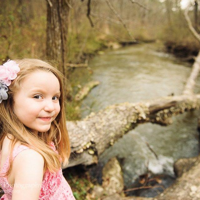 Cute little blond girl shyly smiling at Line Creek in Peachtree City